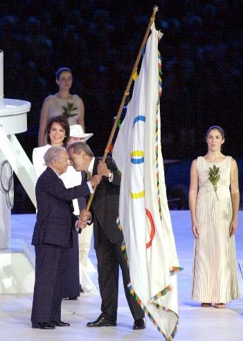 [Ceremonial Olympic flag photo]